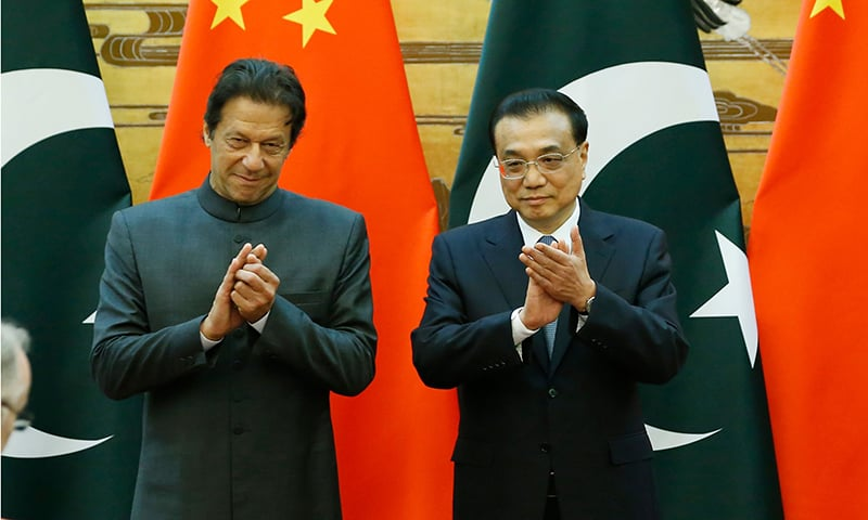 Prime Minister Imran Khan and China's Premier Li Keqiang attend a signing ceremony at the Great Hall of the People in Beijing. — AFP