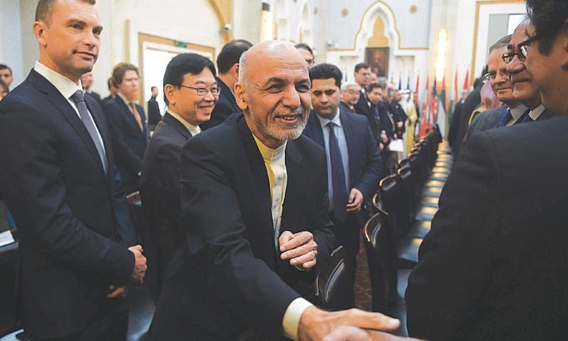 Afghan President Ashraf Ghani shakes hands with a foreign delegate during the Kabul Process conference at the Presidential Palace. —AFP