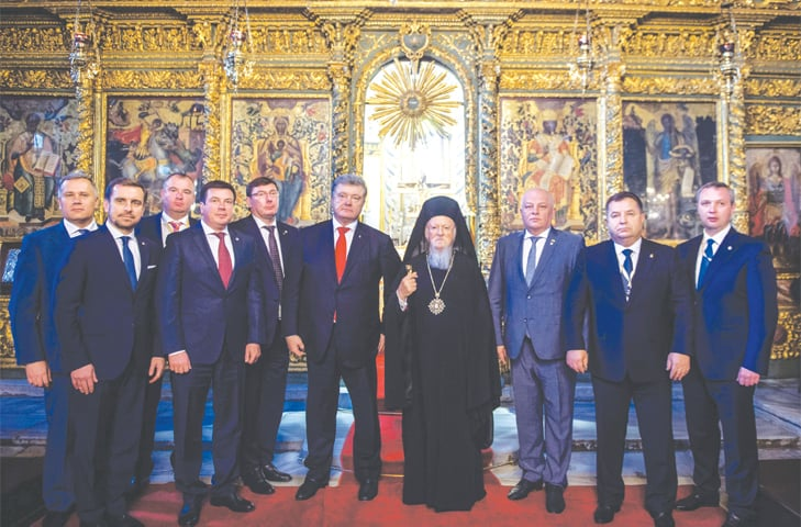 Istanbul: Ukraine's president Petro Poroshenko (centre left) and Ecumenical Patriarch of Constantinople Bartholomew (centre right) pose for a picture after their meeting at the Fener Greek Patriarchate on Saturday.—AFP
