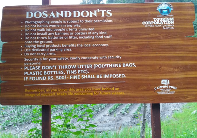 A huge board of rules on littering at the Sharan campsite's entrance