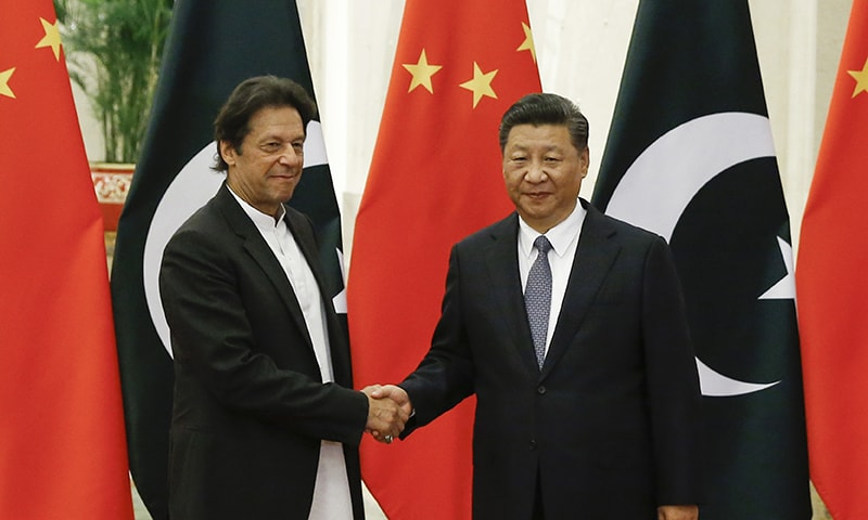 Chinese President Xi Jinping, right, meets Prime Minister Imran Khan at the Great Hall of the People in Beijing on Friday. ─ AP/File