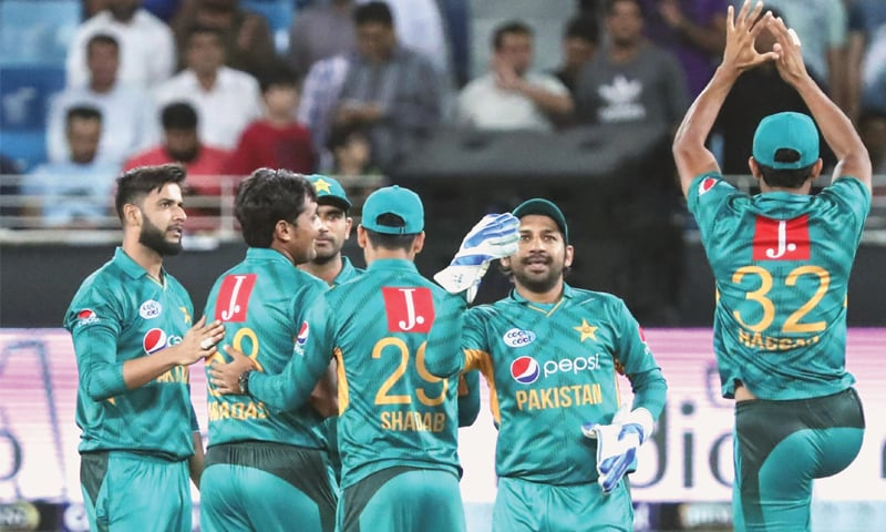 PAKISTANI players celebrate after winning the match against New Zealand.—AFP
