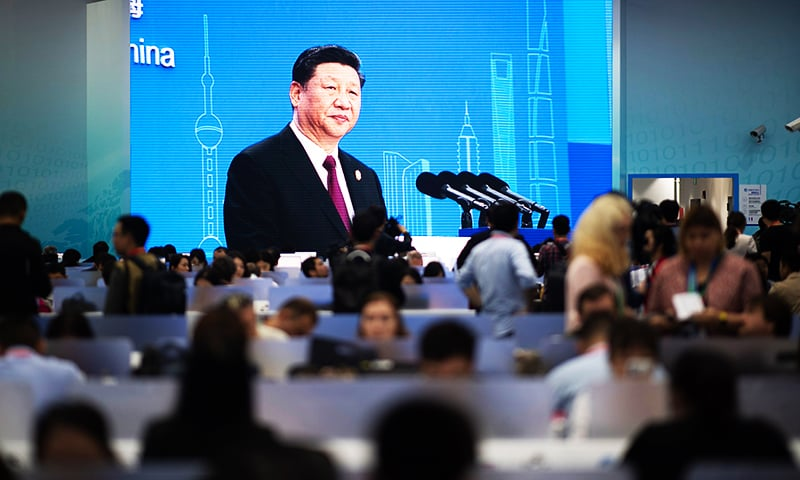 China's President Xi Jinping is seen on a big screen in the media centre as he speaks at the opening ceremony of the first China International Import Expo.— AFP