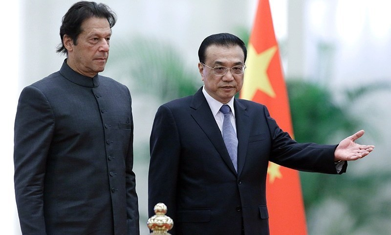 Prime Minister Imran Khan and China's Premier Li Keqiang attend a welcome ceremony at the Great Hall of the People in Beijing on Saturday.—AFP
