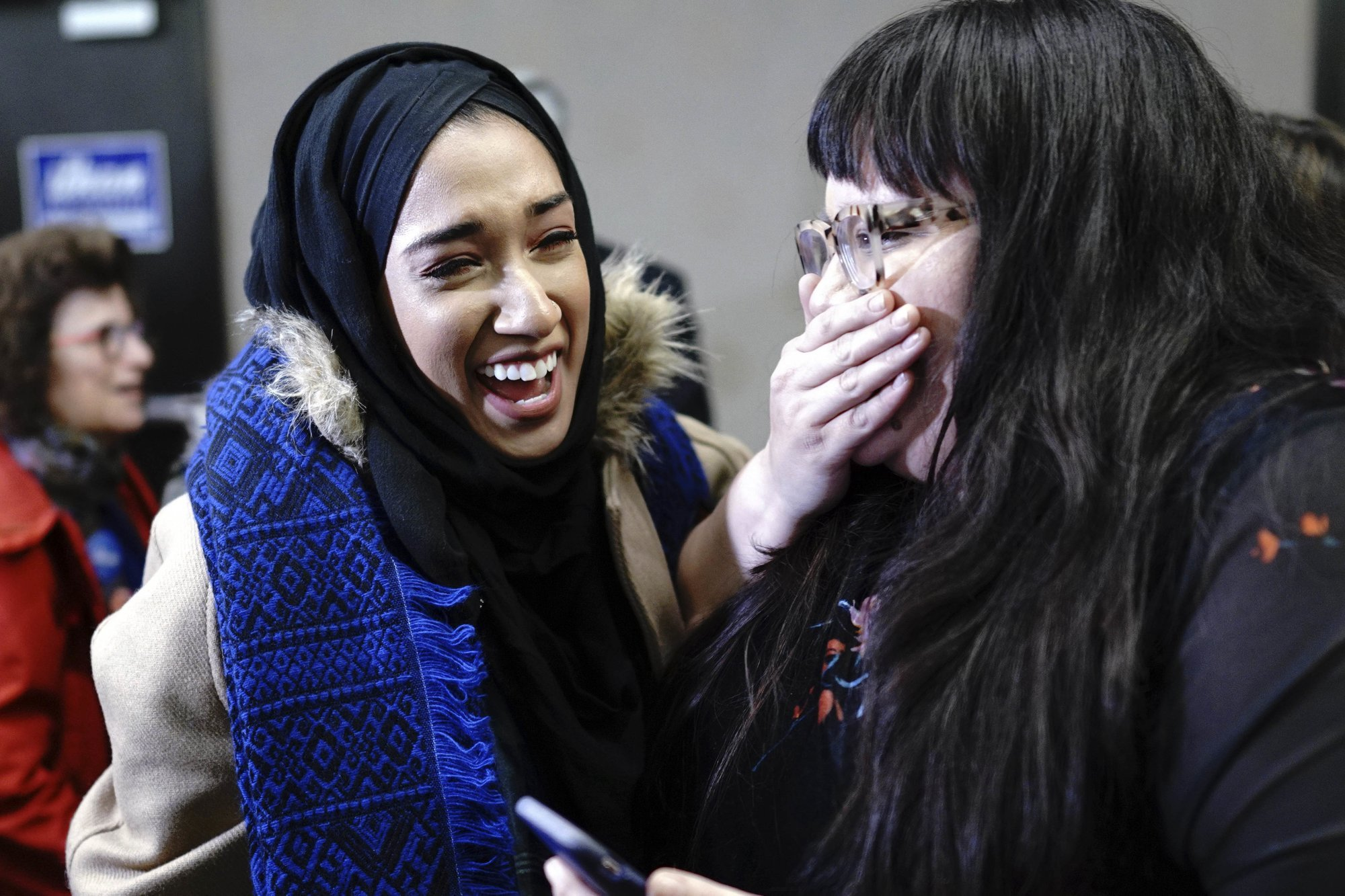Asma Mohammed and Ashley Fairbanks celebrate as results come in at Democratic candidate Ilhan Omar's election night headquarters in Minneapolis on Tuesday. Omar is the first Somali-American elected to Congress. — AP