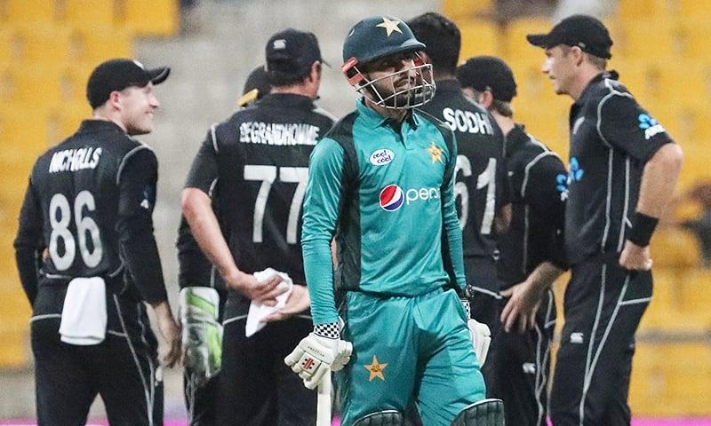 Pakistan's batsman Shadab Khan walks back to the pavilion after his dismissal. —AFP