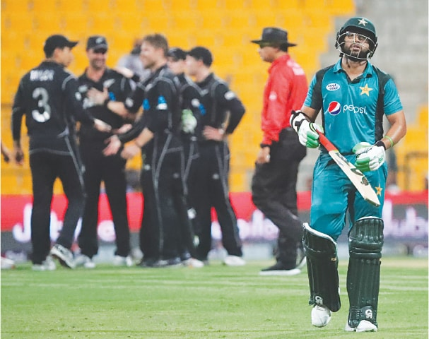A DEJECTED Imam uI Haq walks back to the pavilion after being dismissed during the first one-day international between Pakistan and New Zealand on Wednesday.—AFP