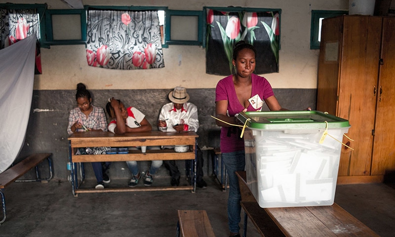 Polling official wait for voters at a polling station of Isotry district in Antananarivo on November 7 during the first round of Madagascar's presidential election. — AFP