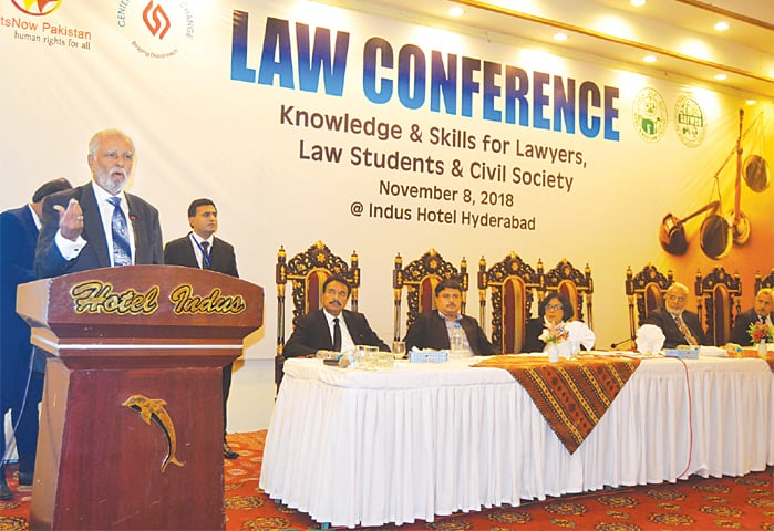 RETIRED Justice Amir Hani Muslim speaks at the conference on Thursday as others look on.—Dawn