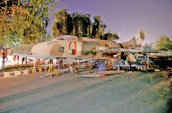 A PAF A-5 Fenton Ground Attack aircraft being placed on a greenbelt near the Potohar metro bus station on Thursday. —White Star