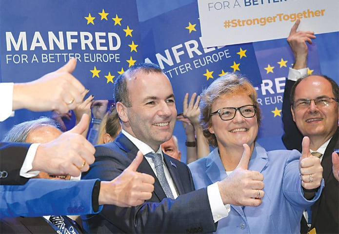 Helsinki (Finland): Manfred Weber of Germany celebrates with his supporters on Thursday.—Reuters