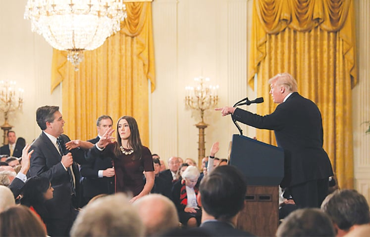 Washington: A White House staff member reaches for the microphone held by CNN's Jim Acosta as he questions US President Donald Trump during a news conference following Tuesday's midterm congressional elections at the White House. Mr Acosta was banned after a heated exchange during which Mr Trump called him a 'rude, terrible person' and an 'enemy of the people'. The White House press secretary later announced the decision to revoke Mr Acosta's pass, claiming it was because Mr Acosta was inappropriately 'placing his hands' on a woman who was taking back a microphone.—Reuters