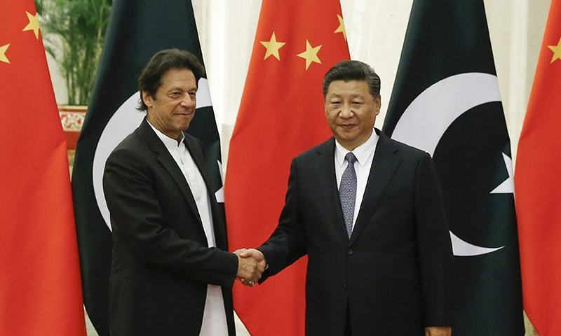 Chinese President Xi Jinping (R), meets Prime Minister Imran Khan at the Great Hall in Beijing earlier this month. — AP/File