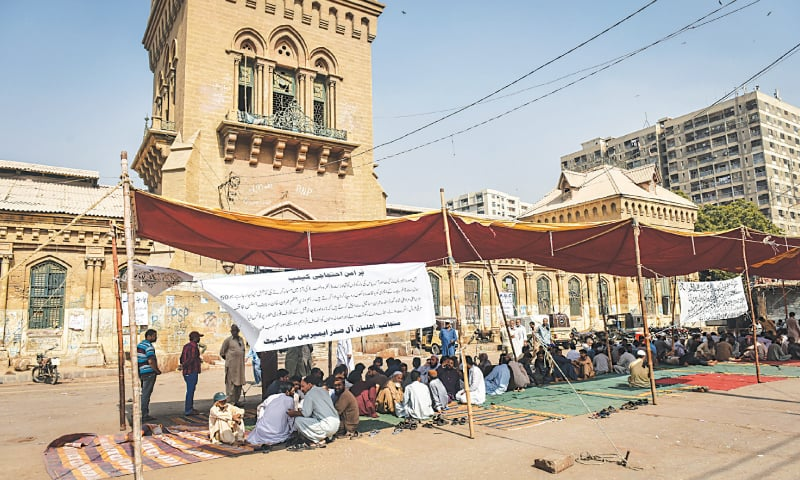 SHOPKEEPERS affected by the anti-encroachment operation that is under way in Saddar stage a sit-in in front of Empress Market on Saturday.—White Star