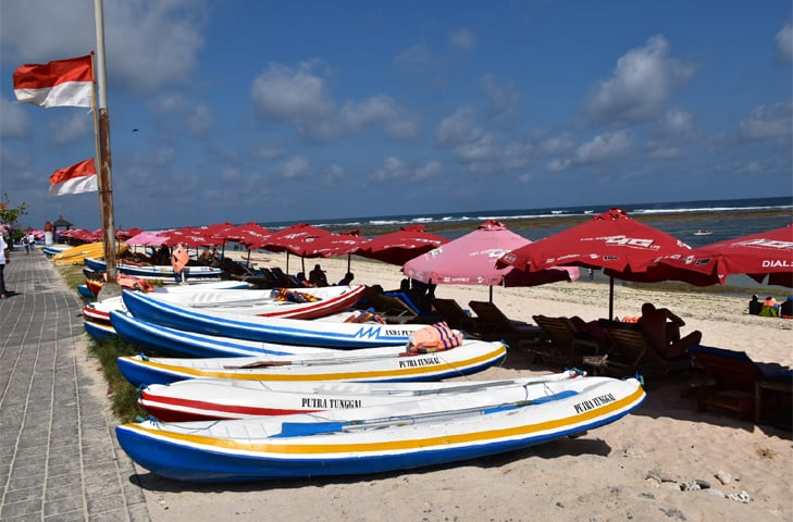 Boats lined up a family beach in Bali