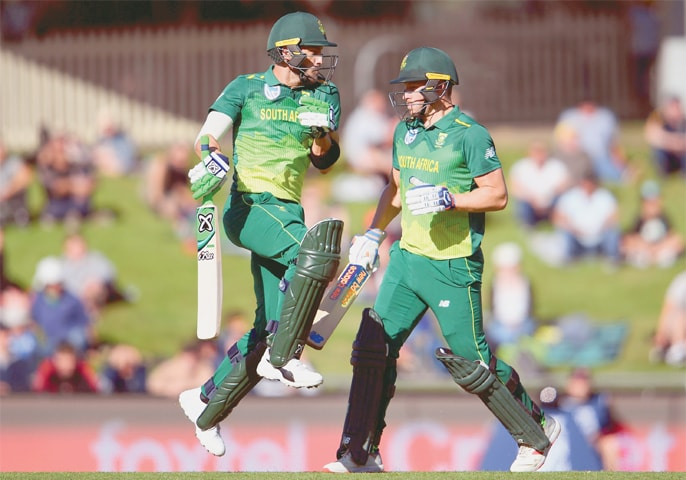 SOUTH African captain Faf du Plessis (L) avoids fellow century-maker David Miller during their marathon partnership  in the third One-day International against Australia at the Bellerive Oval on Sunday.—AFP