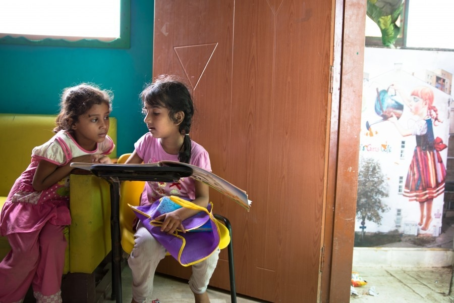 A free non-government school in Karachi's Lyari's neighbourhood provides a few hours of classes per day to children who otherwise have no access to education. *Image by Insiya Syed for Human Rights Watch*