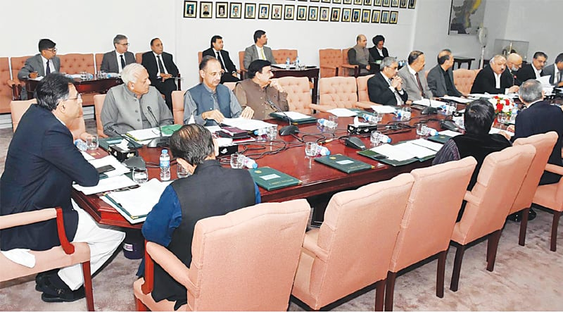 ISLAMABAD:  Federal Minister for Finance Asad Umar chairs a meeting of the Economic Coordination Committee on Monday.—INP
