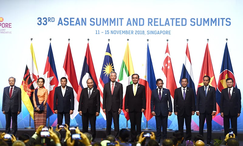 Southeast Asian leaders pose for a group photo at the opening ceremony during the 33rd Association of Southeast Asian Nations (ASEAN) summit in Singapore. — AFP