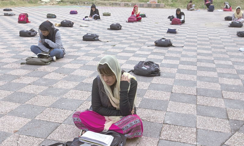 ISLAMABAD: Girls attend a makeshift school at a city park on Tuesday. Human Rights Watch released a 111-page report that said millions of girls in Pakistan are still out of school, mostly because the government spends less money on education. The international rights group said girls are deprived of an education for multiple reasons, including a shortage of government schools.—AP