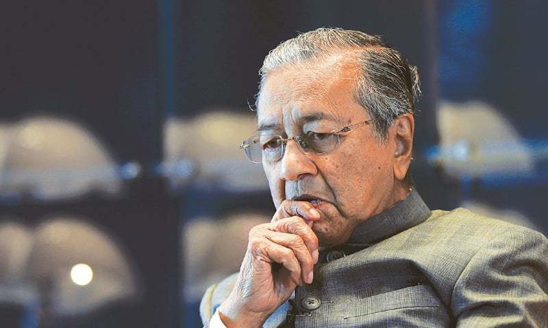 Mahathir says other countries will take their cue from Washington and Beijing if protectionism is allowed to spiral.— Reuters/File
