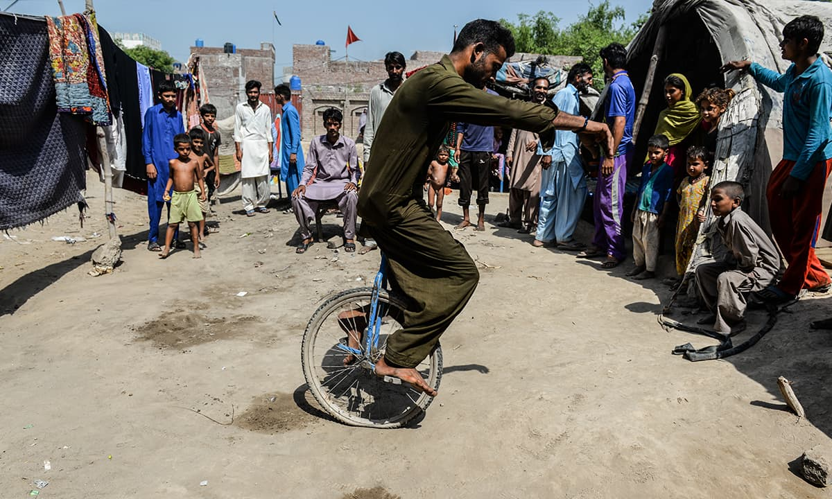 A young man riding a unicycle