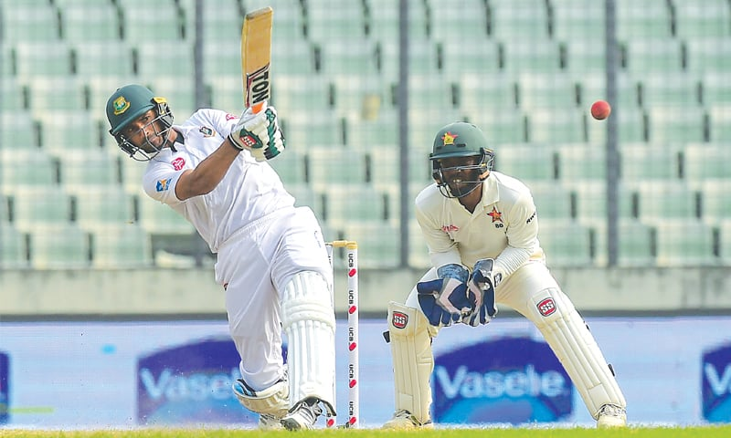 BANGLADESH captain Mahmudullah plays a shot as Zimbabwe wicket-keeper Regis Chakabva looks on during the second Test at the Sher-e-Bangla National Stadium on Wednesday. — AFP