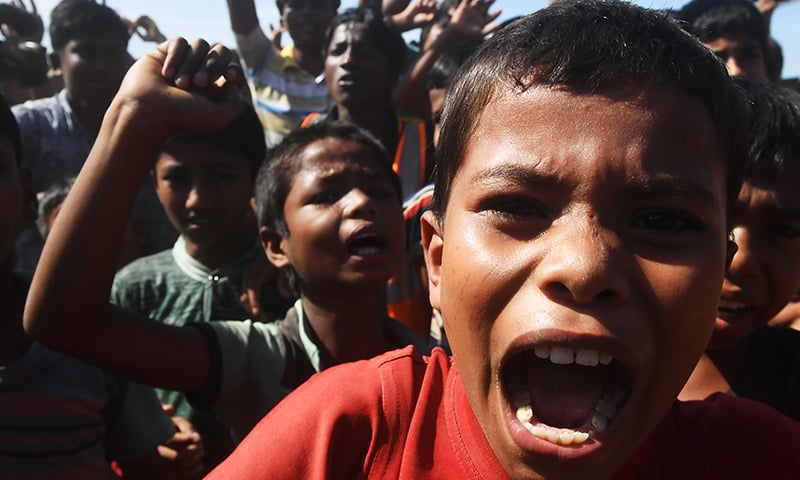 Young Rohingya refugees shout slogans at a protest against a disputed repatriation programme at the Unchiprang refugee camp near Teknaf on November 15, 2018. — AFP