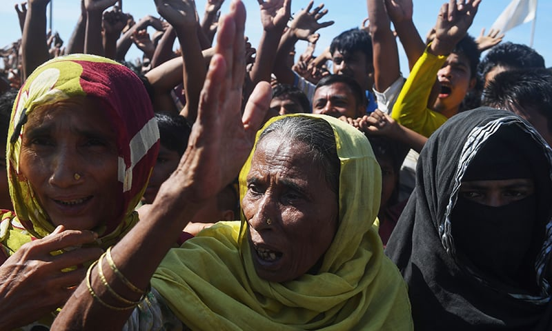 Rohingya refugees shout slogans at a protest against a disputed repatriation programme at the Unchiprang refugee camp near Teknaf on November 15, 2018.  — AFP