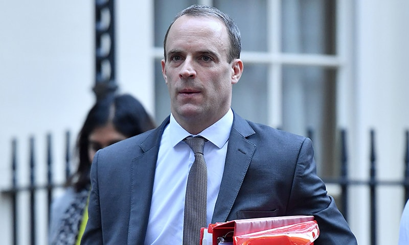 In this file photo taken on November 14, 2018, Brexit Minister Dominic Raab leaves Downing Street in London. — AFP
