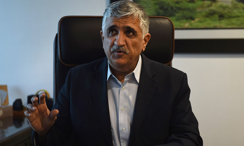 Sindh Engro Coal Mining Company CEO Shamsuddin Shaikh gestures during an interview at his office in Karachi. ─AFP