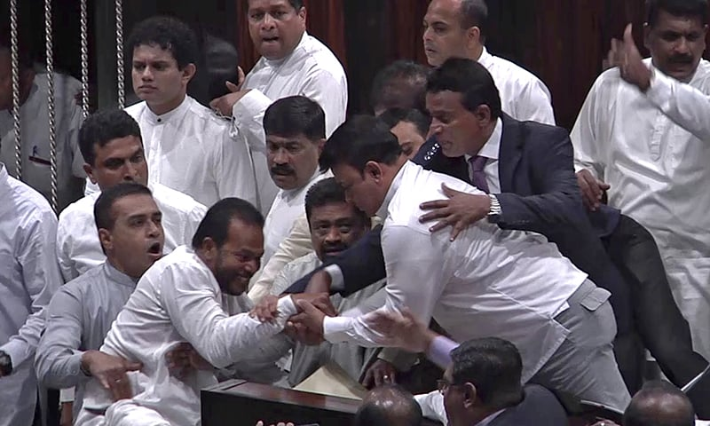 In this image made from video, Sri Lanka's lawmakers scuffle at the parliament in Colombo, Thursday, November 15, 2018. —AP