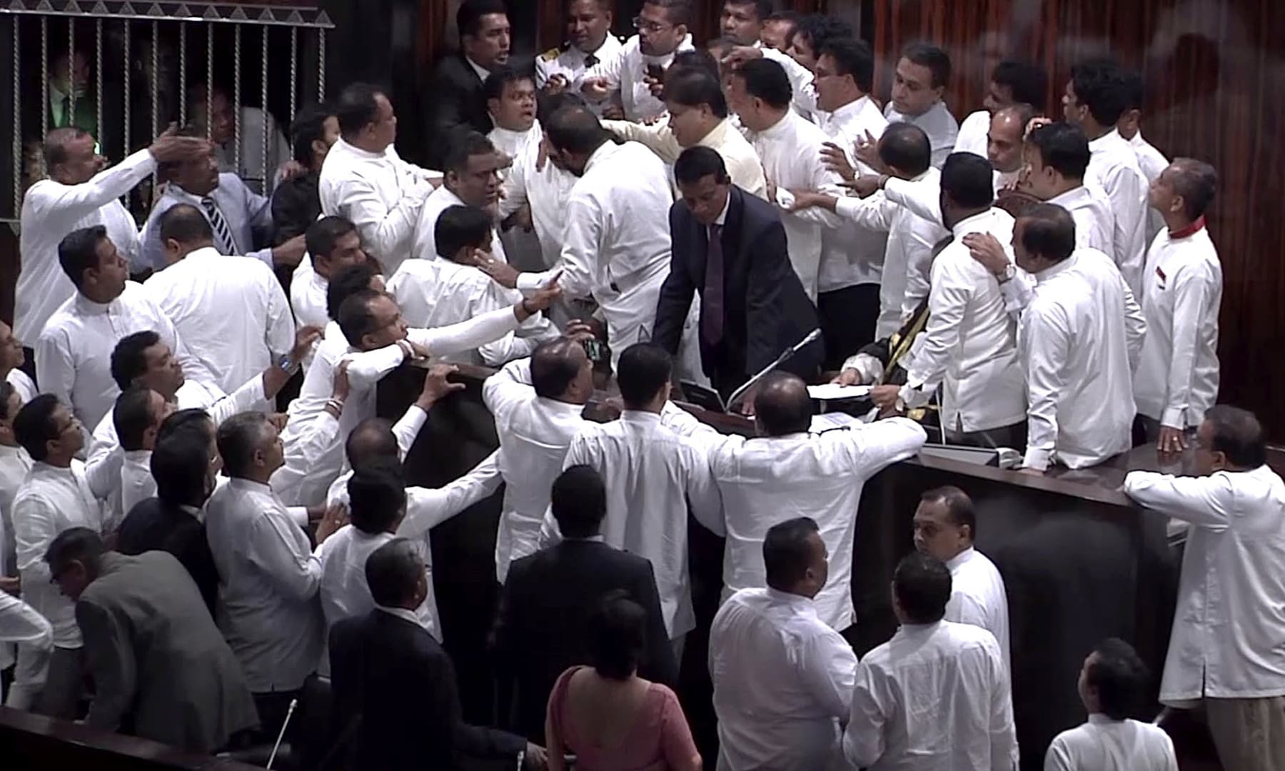 Rival lawmakers exchange blows in Sri Lanka's Parliament as the disputed Prime Minister Mahinda Rajapaksa claimed the speaker had no authority to remove him from office by voice vote. —AP