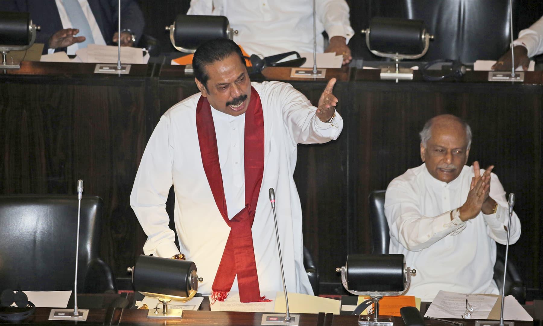 Sri Lankan disputed Prime Minister Mahinda Rajapaksa speaks at the parliament chamber in Colombo, Sri Lanka, Thursday, November 15, 2018. —AP