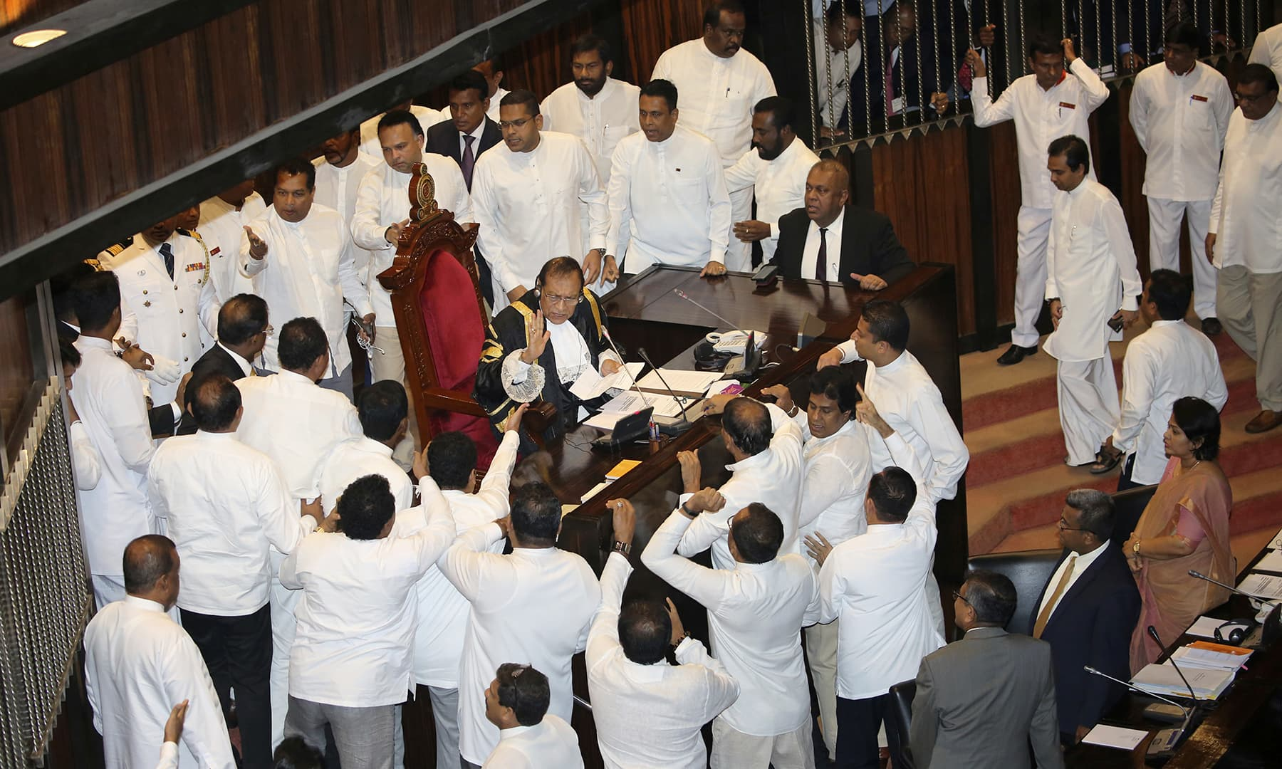 Sri Lankan Lawmakers surround speaker Kaku Jayasuriya during a session at the parliament chamber in Colombo, Sri Lanka, Thursday, November 15, 2018. —AP