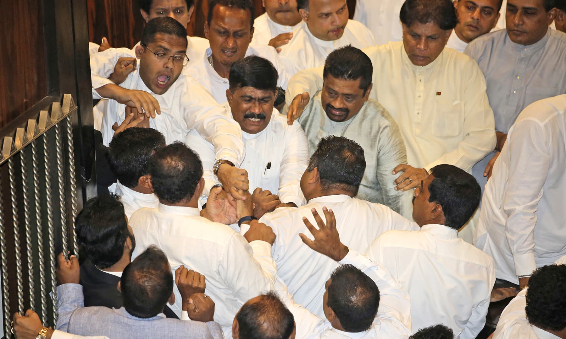 Sri Lankan Lawmakers fight in the parliament chamber in Colombo, Sri Lanka, Thursday, November 15, 2018. —AP