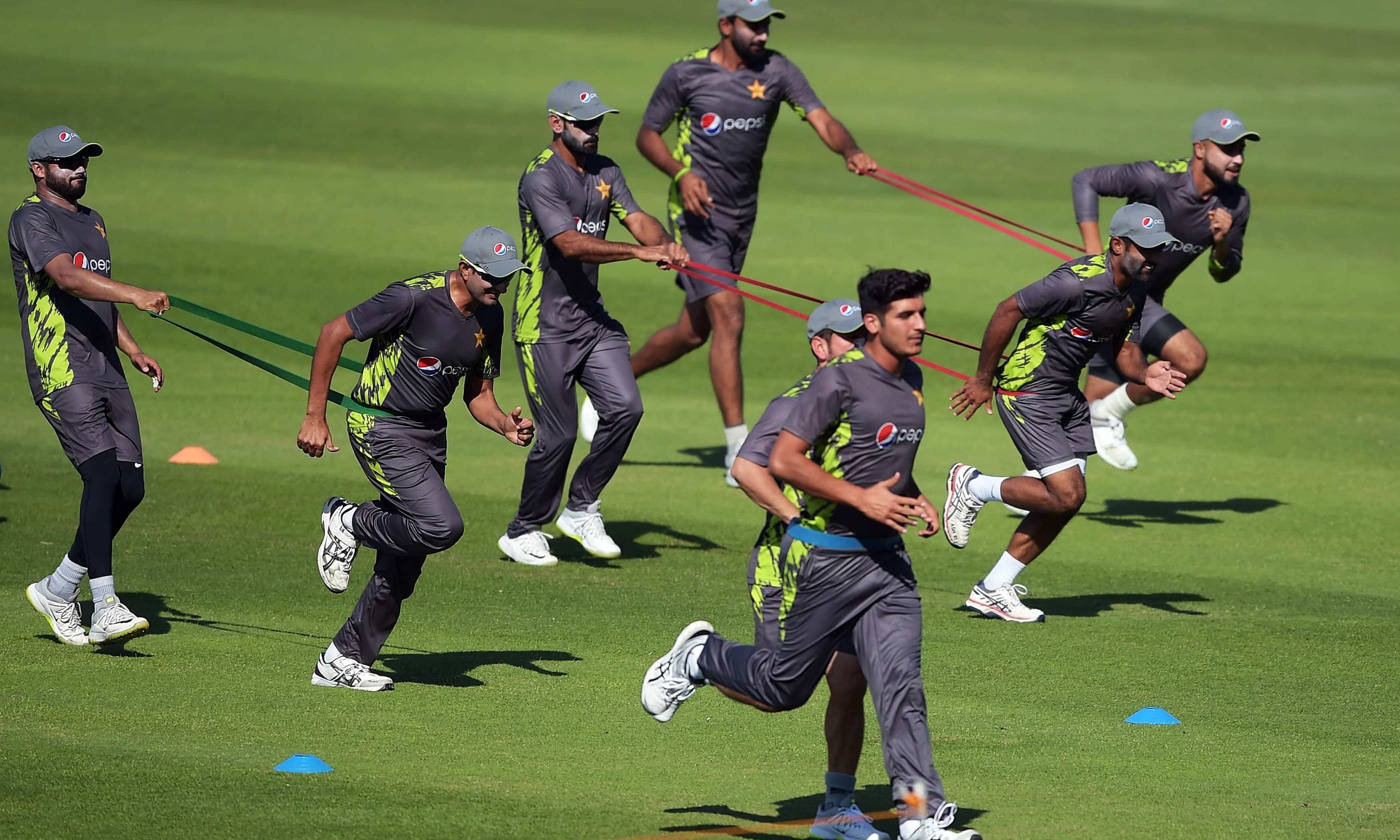 Pakistani cricketers take part in a practice session at the Zayed International Cricket Stadium in Abu Dhabi. —AFP