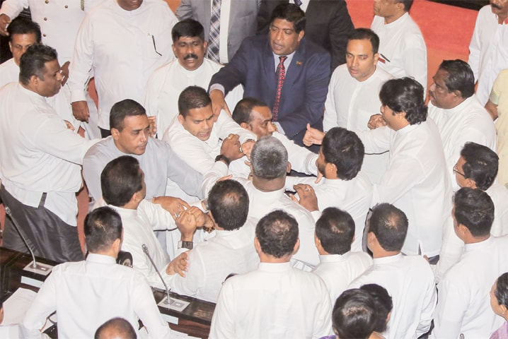 Colombo: Rival members of the Sri Lankan parliament clash during a session on Thursday.—AFP