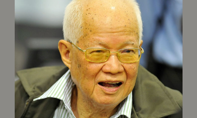 In this photo released by the Extraordinary Chambers in the Courts of Cambodia, Khieu Samphan, former Khmer Rouge head of state, smiles during the second day of a trial  of the former Khmer Rouge top leaders, in Phnom Penh, Cambodia, Tuesday, Nov. 22, 2011. — AP/File