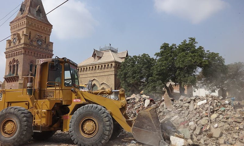 KMC authorities backed by heavy contingents of police and Rangers brought heavy machinery to the Empress Market on Saturday night.—Urban Resource Center