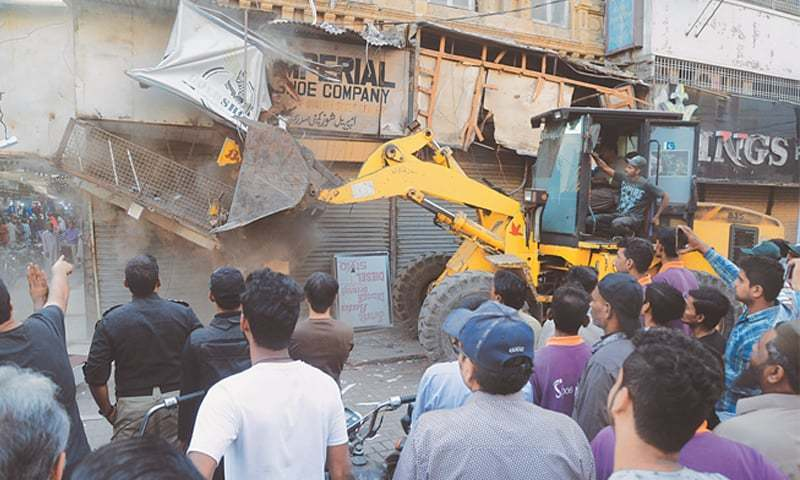 Heavy machinery was used to remove an illegal signboard in Saddar on Friday November 2.—White Star