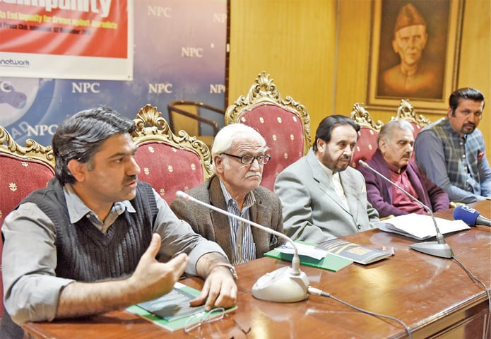 The report's author, Adnan Rehmat, speaks at the launch on Friday. Former senator Farhatullah Babar is also seen. — White Star