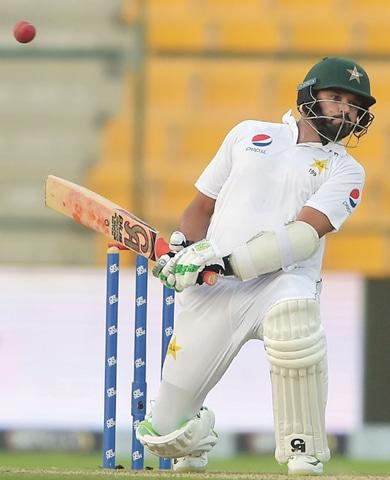 PAKISTAN batsman Azhar Ali avoids a short ball from New Zealand pacer Trent Boult on Friday.—AFP