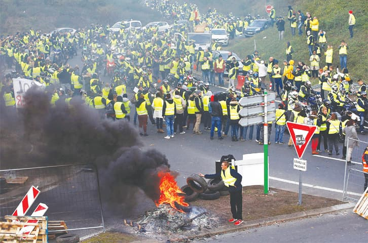 One dead, dozens injured in fuel tax protests around France