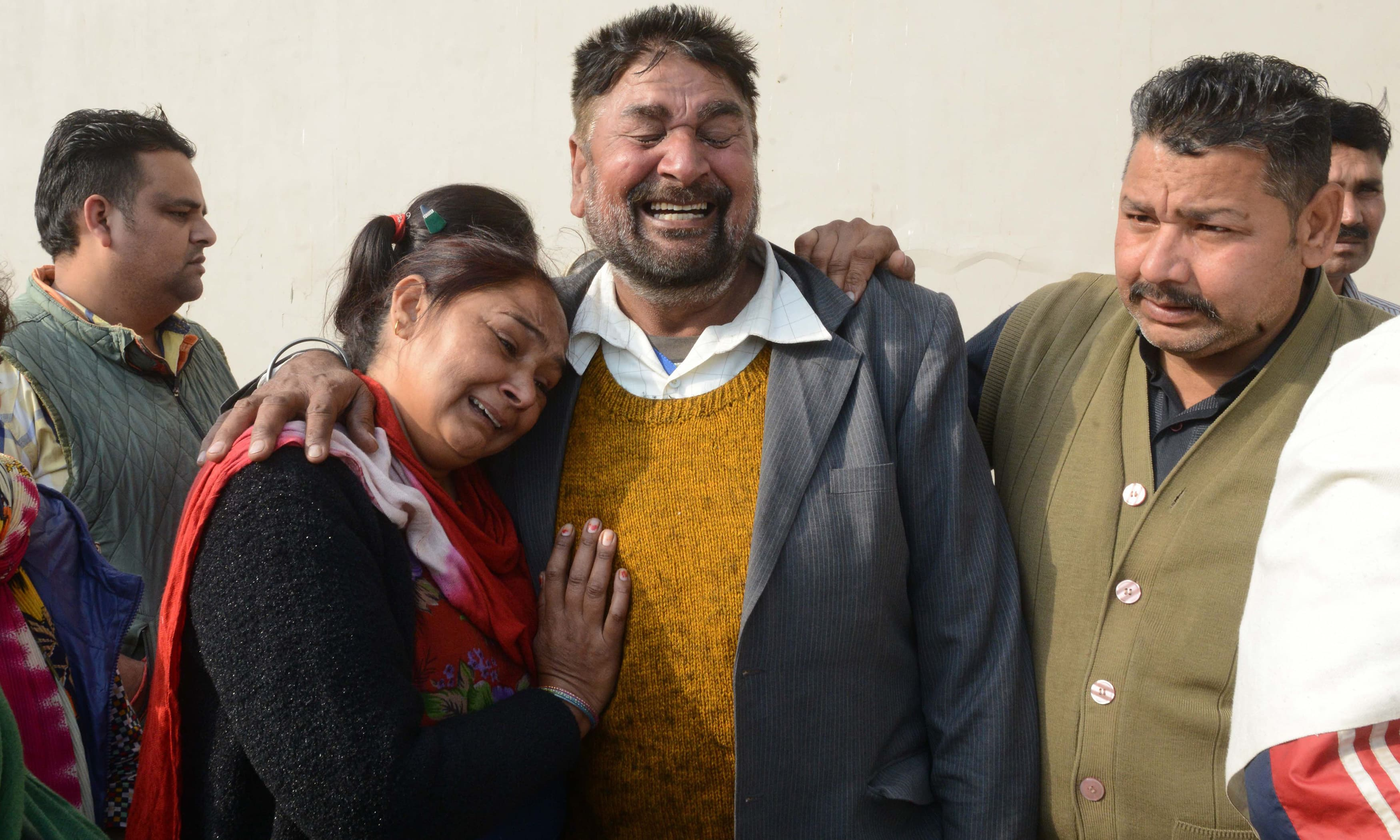 Relatives of Sukhdev Singh, who was killed in a grenade attack at the Nirankari Satsang Bhawan, weep at a hospital in Amritsar. —AFP
