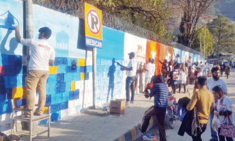 Students participate in the street art competition in Abbottabad on Sunday. — Dawn