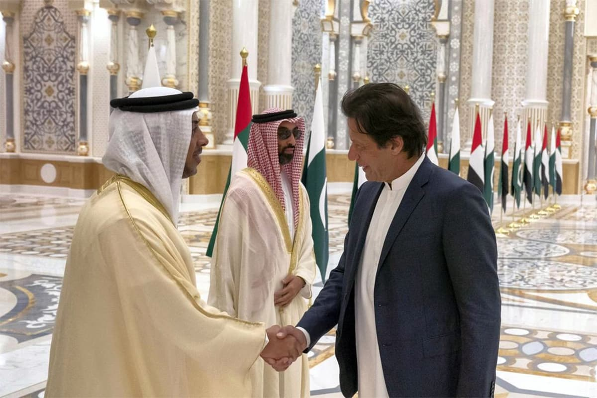 Prime Minister Imran Khan shakes hands with Sheikh Mansour bin Zayed during his visit to Presidential Palace, Abu Dhabi. — Photo courtesy UAE Ministry of Presidential Affairs