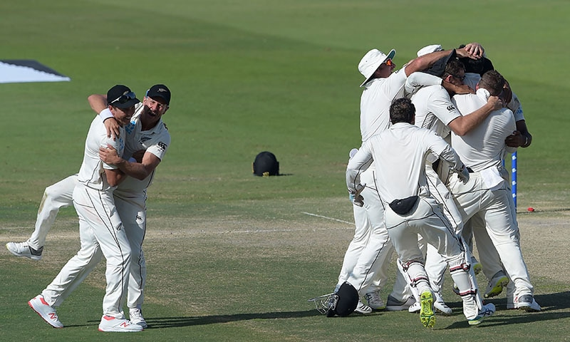 New Zealand cricketers celebrate after beating Pakistan in the first Test cricket match between Pakistan and New Zealand at the Sheikh Zayed International Cricket Stadium in Abu Dhabi on November 19, 2018.  — AFP