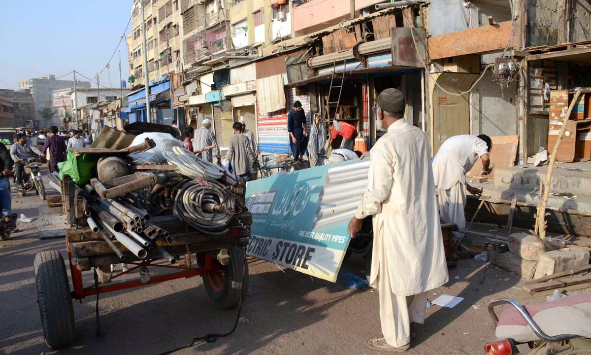 Shopkeeper shift items before an anti-encroachment drive near Light House. —APP