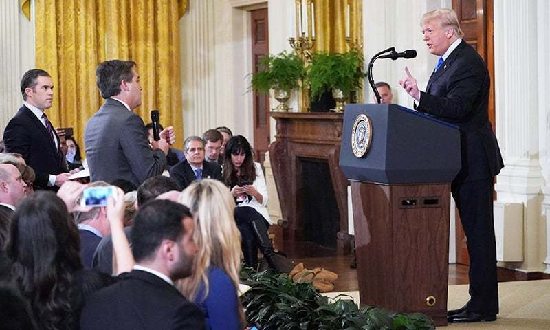 In this file photo taken on November 7, 2018 US President Donald Trump (R) gets into a heated exchange with CNN chief White House correspondent Jim Acosta (C). — AFP/File